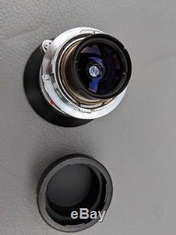 Leica 21mm Super-Angulon 14/21 (M-mount) + rear cap + hood