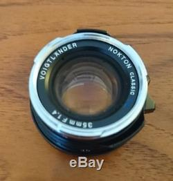 Voigtlander 35mm 1.4 M Mount (Leica) with lens hood